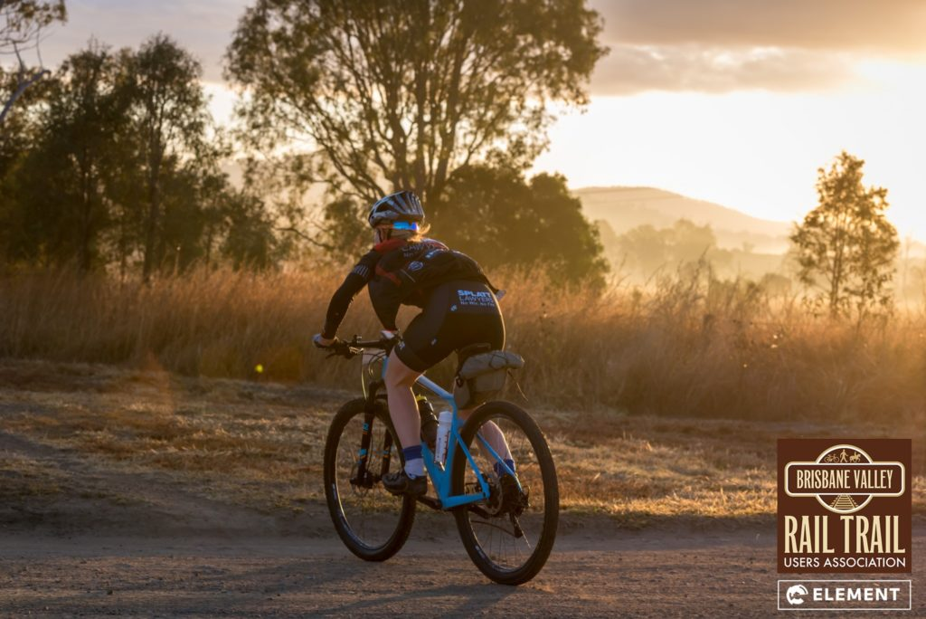 A rider goes enjoys the sunrise on the Brisbane Valley Rail Trail
