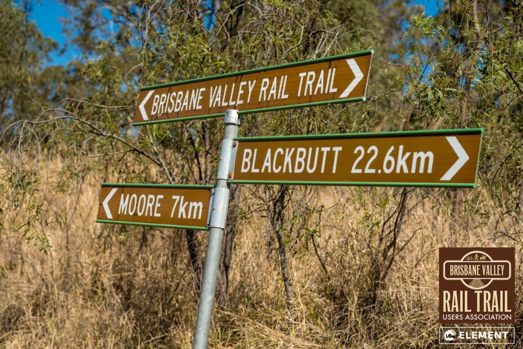 A sign makes the distance of the Brisbane Valley Rail Trail