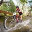 A rider blasts through the water at Karingal Scout Camp