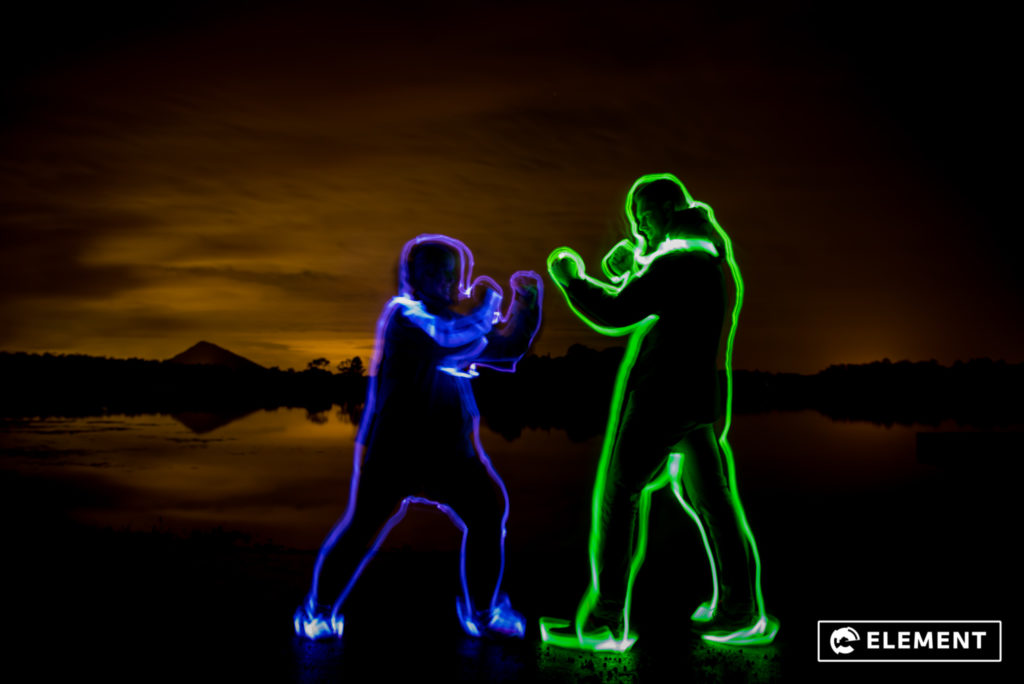 Students practice light-painting.