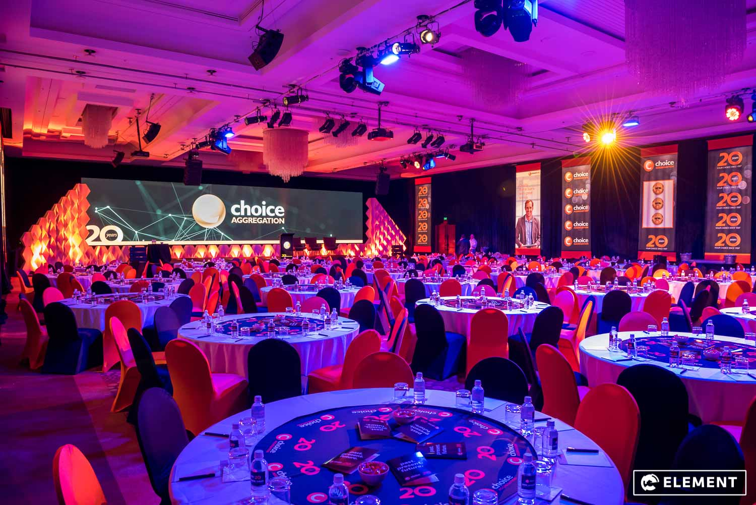 A large room is set for a corporate event.