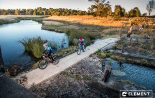 Riders cross a creek