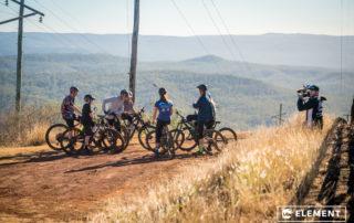 Riders chatting overlooking the Toowoomba range.