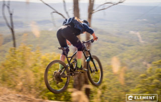 A young rider flys down the trail.